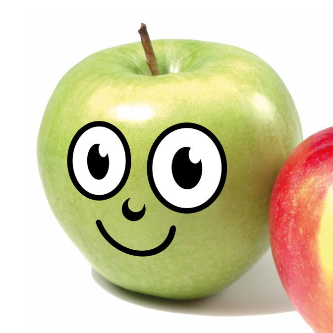 Grüner Apfel mit einem aufgemalten lachenden Gesicht als Symbol für die Apfelchallenge